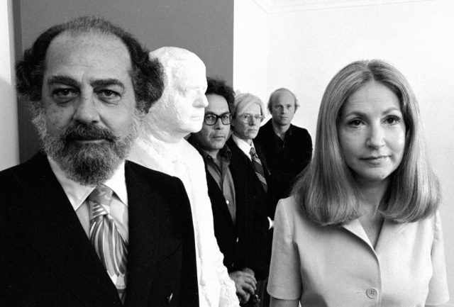 Portrait of art collectors Robert and Ethel Scull as they pose with artists George Segal, Andy Warhol, and James Rosenquist, at the Scull's home, November 1973. Photo by Jack Mitchell/Getty Images.