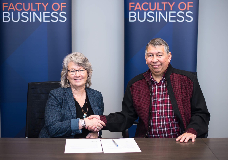 Dr. Deborah Hurst and Gerald Whitford at signing of partnership in October 2018