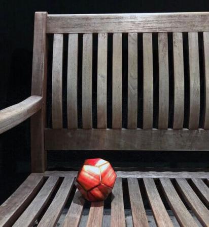 Reddish-orange light orb on a bench