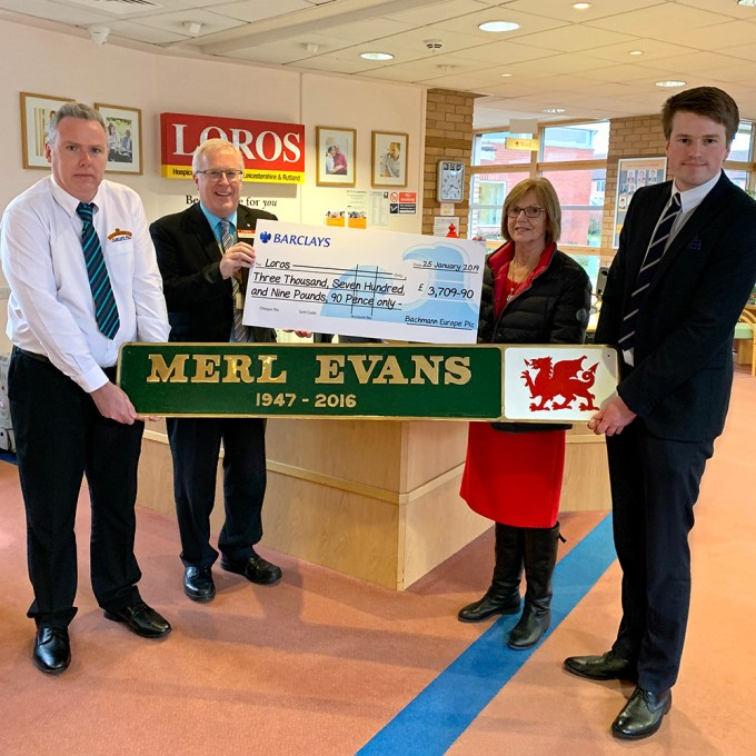 The cheque was presented by Merl's widow, Maureen Evans to Adrian Walker, Senior Fundraiser & Community Lead at Loros. Maureen was joined by Bachmann Europe's Communications Manager, Richard Proudman, and Product Researcher, Steve Smith.