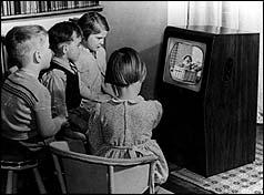 Children watching black and white TV