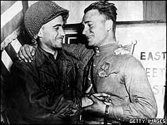 American GI greeting Russian soldier with handshake and arms round shoulders