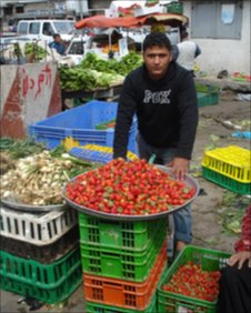 Man selling strawberries in Gaza