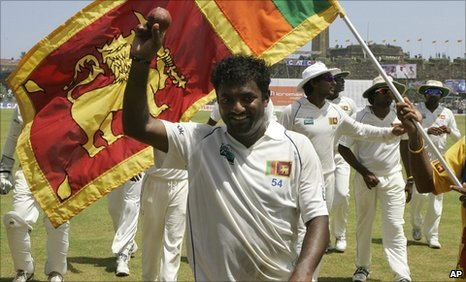 Muttiah Muralitharan leads Sri Lanka off the field after taking 5-63 in the first innings of his final Test