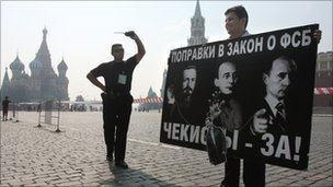 A Yabloko opposition activist holds a poster condemning the new law on Red Square, 26 July