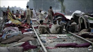 People sheltering on railway line in Nowshera, Pakistan