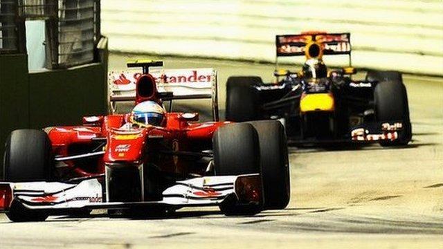 Ferrari driver Fernando Alonso with Red Bull's Sebastian Vettel just behind him at the Singapore Grand Prix