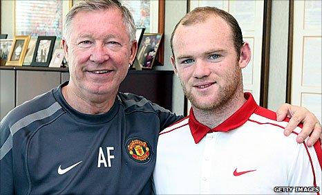 Manchester United manager Sir Alex Ferguson and Wayne Rooney