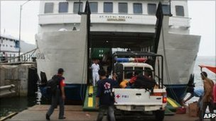 Rescue workers on a ferry in Padang, Sumatra, Indonesia (26 Oct 2010)