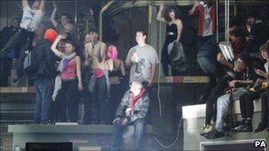 Revellers inside the suspected illegal rave in Museum Street, central London,