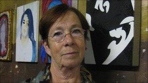 Arsene van Nierop standing by the portrait of her daughter Hester, who was murdered in 1998