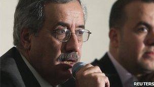 Lebanon's Minister of Telecommunications Sherbel Nahhas (l)