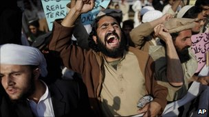 Pakistanis protest against US drone attacks in Islamabad on 10 December 2010