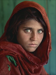 Sharbat Gula, Afghan Girl, at Nasir Bagh refugee camp near Peshawar, Pakistan, 1984.