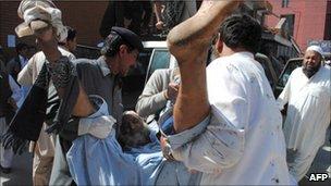 An injured man is taken into the hospital in Peshawar