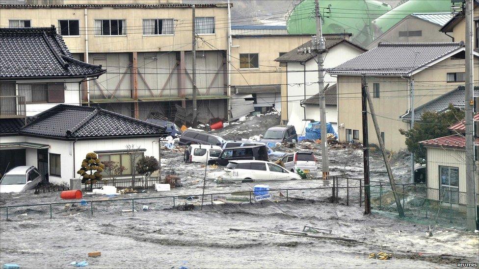 Flooding around buildings in Kesennuma, Japan 11 March 2011