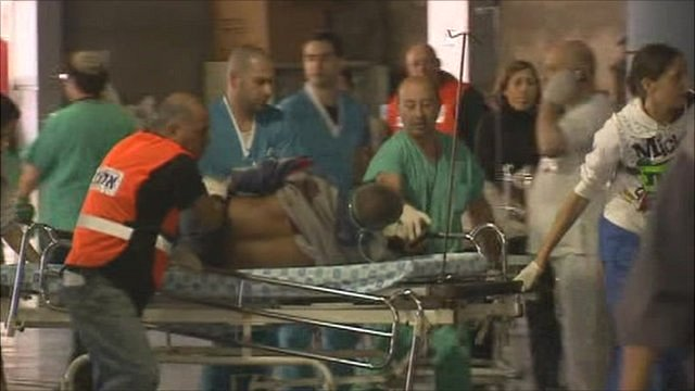 Hospital staff attend to the injured