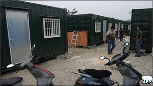 Workers modify freight containers that are being converted into houses in Puli, central Nantou county on 28 April 2011
