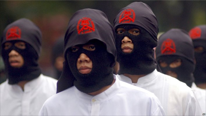 Masked Muslims in protest in Solo, Java, Indonesia.