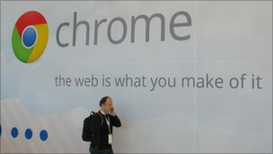 Man speaking on mobile walks past Chrome advert