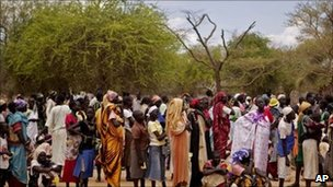 Women line up for food distribution in a makeshift camp for internally displaced people in the village of Mayen Abun, southern Sudan on Thursday May 26, 2011