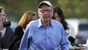 Rupert Murdoch, playing golf in Idaho, speaks to reporter