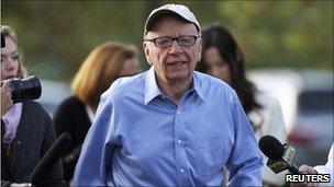Rupert Murdoch, playing golf in Idaho, speaks to reporter