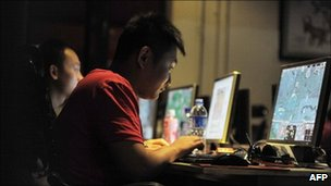 People at an internet cafe in Beijing, May 12, 2011