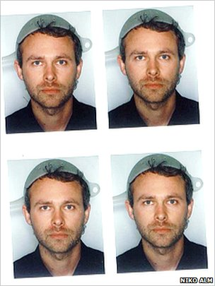 Passport photos of Niko Alm with a colander on his head