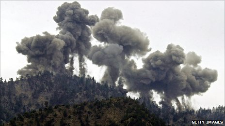 An explosion rocks al-Qaeda positions in the Tora Bora mountains after an attack by US warplanes on 14 December 2001
