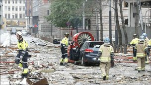 Rescue workers continue to work at the site of the bomb that rocked central Oslo