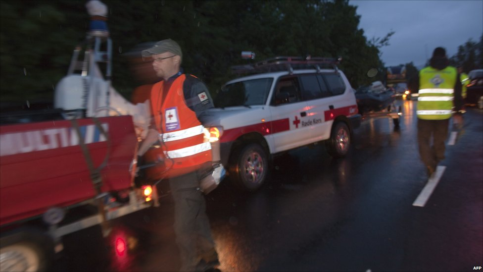 Police and emergency services vehicles on Utoeya, Norway, 22 July 2011