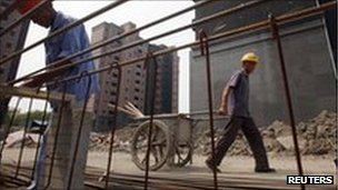 Workers on a residential construction site in Shanghai September 8, 2011