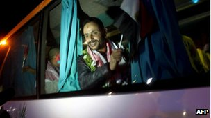 The 25 Egyptian detainees released by Israel cross into Egypt by bus from Israel through the Taba crossing in the Sinai peninsula under heavy security on October 27, 2011