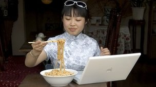 Chinese woman using computer