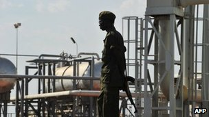 A Southern Sudanese soldier standing next to the infrastructure of an field processing facility in Unity State (file picture)