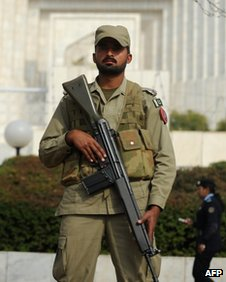 A Pakistani paramilitary soldier stands guard outside the supreme court building during the corruption case hearing in Islamabad on February 2, 2012.
