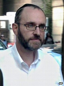 Menachem Youlus leaves federal court in New York after appearing on mail and wire fraud charges 24 August 2011