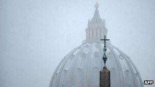 Snow falling over St Peter's Basilica at the Vatican on 3 February 2012