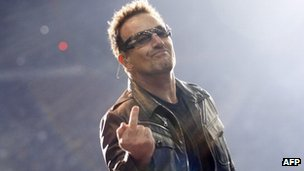 Bono gives the finger