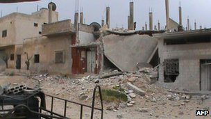 A picture shows the destruction of homes allegedly by Syria government forces in the city of Rastan, on 18 April 2012