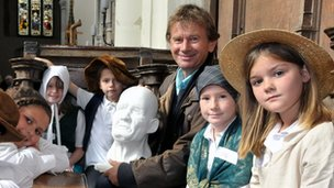 Michael Wood with school children at St Gregory's Church, Sudbury