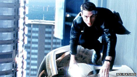 Tom Cruise on top of a car in the film Minority Report