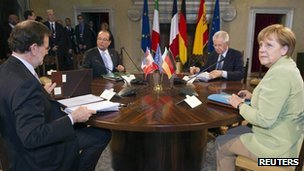 The French, German, Italian and Spanish leaders sit around a table
