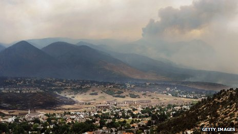 Smoke from the Waldo Canyon fire drapes the foothills on 27 June 2012 in Colorado Springs, Colorado.