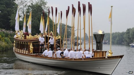 The Gloriana sets forth carrying the Olympic Torch
