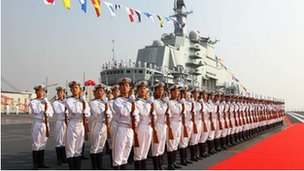 "Naval honour guards stand as they wait for a review on China""s aircraft carrier ""Liaoning"" in Dalian, Liaoning province, September 2012"