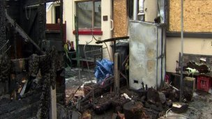 The scene at the rear of the house attacked by arsonists