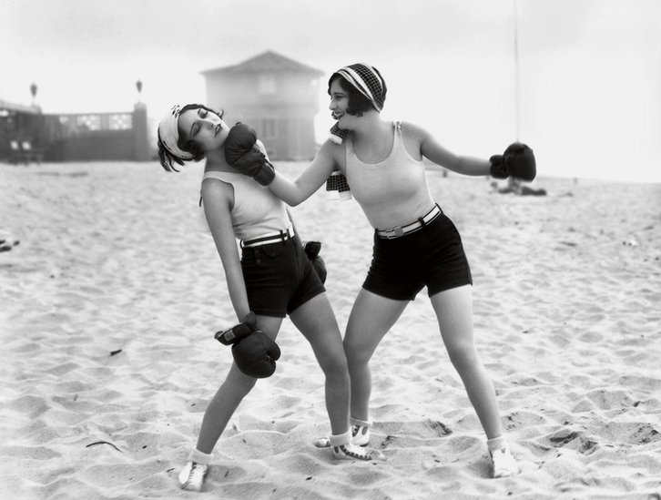 Starlets Dorothy Sebastian and Joan Crawford larking about on Santa Monica Beach, California, MGM, 1928 (Photo by Don Gillum)