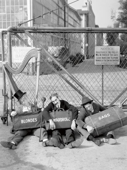 Harpo, Groucho and Chico Marx outside the gates of the Los Angeles Studios MGM, 1938 (Photo by Virgil Apger)